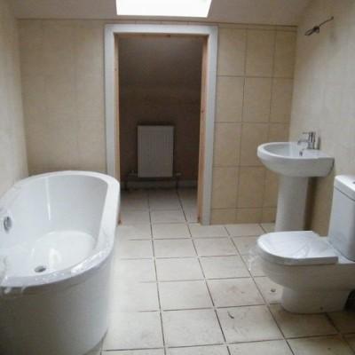 Bathroom after new plaster and tiles Tunbridge Wells