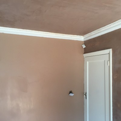 Wall freshly coated with new plaster ready for finishin, ceiling now completed