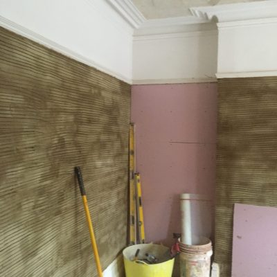 1st coat of plaster in living area