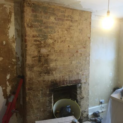 Loose plaster removed prior to Plastering