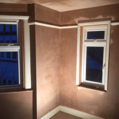 Plaster repaired around window